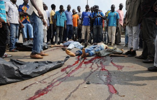 Top 10 Most Dangerous Cities In 2014of Alassane Ouattara stand nex